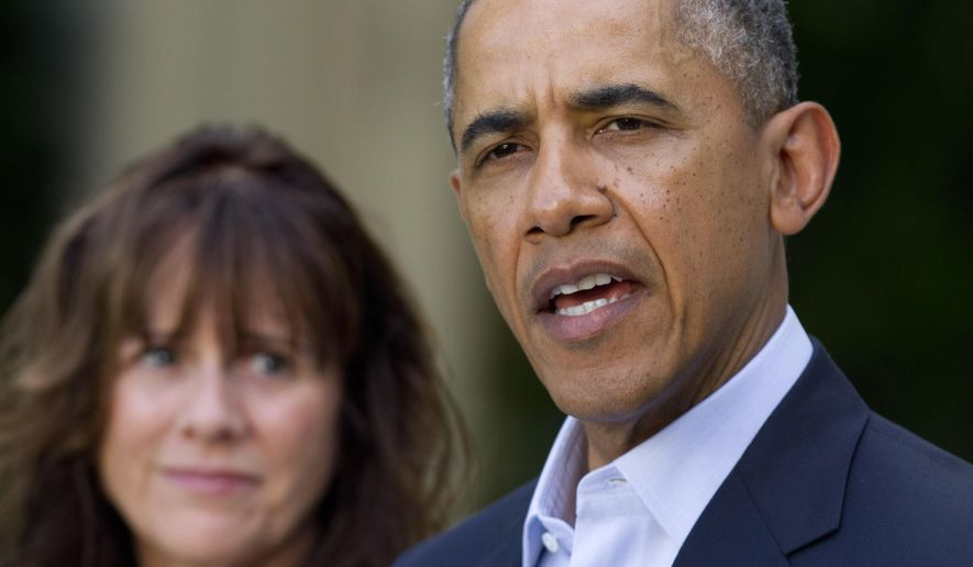 Jani Bergdahl, mother of U.S. Army Sgt. Bowe Bergdahl, listens as President Barack Obama speaks about the release of her son, during a news conference in the Rose Garden of the White House in Washington on Saturday, May 31, 2014. Bergdahl, 28, had been held prisoner by the Taliban since June 30, 2009. He was handed over to U.S. special forces by the Taliban in exchange for the release of five Afghan detainees held by the United States. (AP Photo/Jacquelyn Martin)