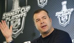 New York Rangers head coach Alain Vigneault answers a reporter's question during a news conference following a practice at the team's training facility in Greenburgh, N.Y., Sunday, June 1, 2014. (AP Photo/Kathy Willens)
