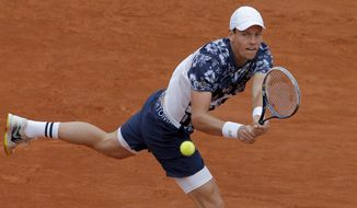 Tomas Berdych of the Czech Republic returns the ball during the fourth round match of the French Open tennis tournament against John Isner of the U.S. at the Roland Garros stadium, in Paris, France, Sunday, June 1, 2014.  (AP Photo/Michel Spingler)