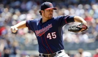 Minnesota Twins' Phil Hughes delivers a pitch during the first inning of a baseball game against the New York Yankees, Sunday, June 1, 2014, in New York. (AP Photo/Jason DeCrow)