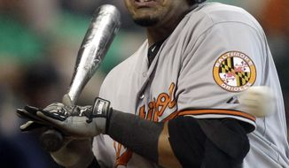 Baltimore Orioles' Nelson Cruz is hit by a pitch during the third inning of a baseball game against the Houston Astros, Sunday, June 1, 2014, in Houston. (AP Photo/Patric Schneider)