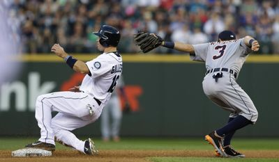 Seattle Mariners' Cole Gillespie, left, reaches second base past Detroit Tigers second baseman Ian Kinsler on a single by Willie Bloomquist in the second inning of a baseball game, Saturday, May 31, 2014, in Seattle. (AP Photo/Ted S. Warren)