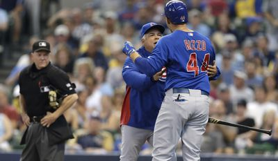 Chicago Cubs manger Rick Renteria, second from right, tries to restrain Anthony Rizzo (44) who argues with home plate umpire Jerry Meals in the fourth inning of a baseball game against the Milwaukee Brewers, Sunday, June 1, 2014, in Milwaukee. Rizzo was ejected from the game. (AP Photo/Jeffrey Phelps)