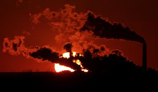 In this March 8, 2014 file photo steam from the Jeffrey Energy Center coal-fired power plant is silhouetted against the setting sun near St. Marys, Kan. As President Barack Obama prepares to announce tougher new air quality standards affecting coal-fired power plants, lawmakers in about a half-dozen state already have acted pre-emptively. Not to toughen their own standards, but to make it tougher to enforce the new federal ones. (AP Photo/Charlie Riedel, File)