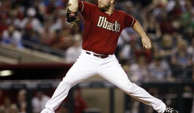 Arizona Diamondbacks starting pitcher Wade Miley throws in the first inning during a baseball game against the Cincinnati Reds, Sunday, June 1, 2014, in Phoenix. (AP Photo/Rick Scuteri)
