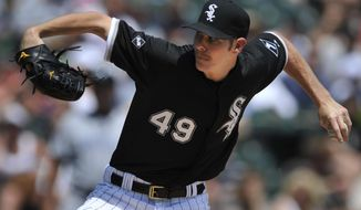 Chicago White Sox starter Chris Sale delivers a pitch during the third inning of an interleague  baseball game against the San Diego Padres in Chicago, Sunday, June 1, 2014. (AP Photo/Paul Beaty)