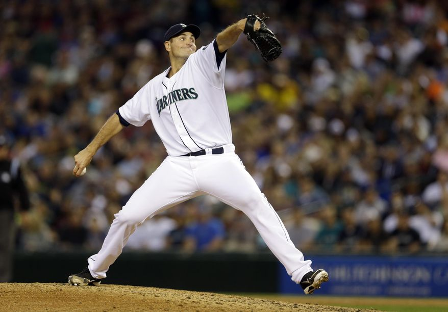 Seattle Mariners starting pitcher Chris Young throws in the sixth inning of a baseball game against the Detroit Tigers, Saturday, May 31, 2014, in Seattle. (AP Photo/Ted S. Warren)