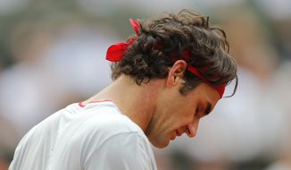 Switzerland's Roger Federer looks down as he plays Latvia's Ernests Gulbis during their fourth round match of  the French Open tennis tournament at the Roland Garros stadium, in Paris, France, Sunday, June 1, 2014. (AP Photo/David Vincent)