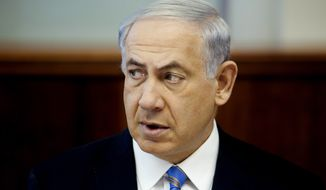 Israeli Prime Minister Benjamin Netanyahu speaks during a cabinet meeting in Jerusalem, Sunday, June 1, 2014. (AP Photo/Dan Balilty, Pool)