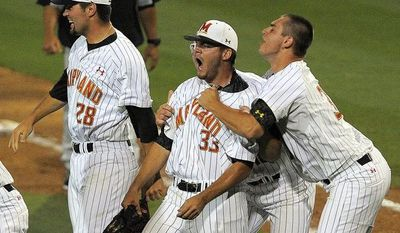 Maryland pitcher Kevin Mooney (33) celebrates with teammates after the final out of an NCAA college baseball tournament regional game against South Carolina in Columbia, S.C., Saturday, May 31, 2014. (AP Photo/Stephen B. Morton)
