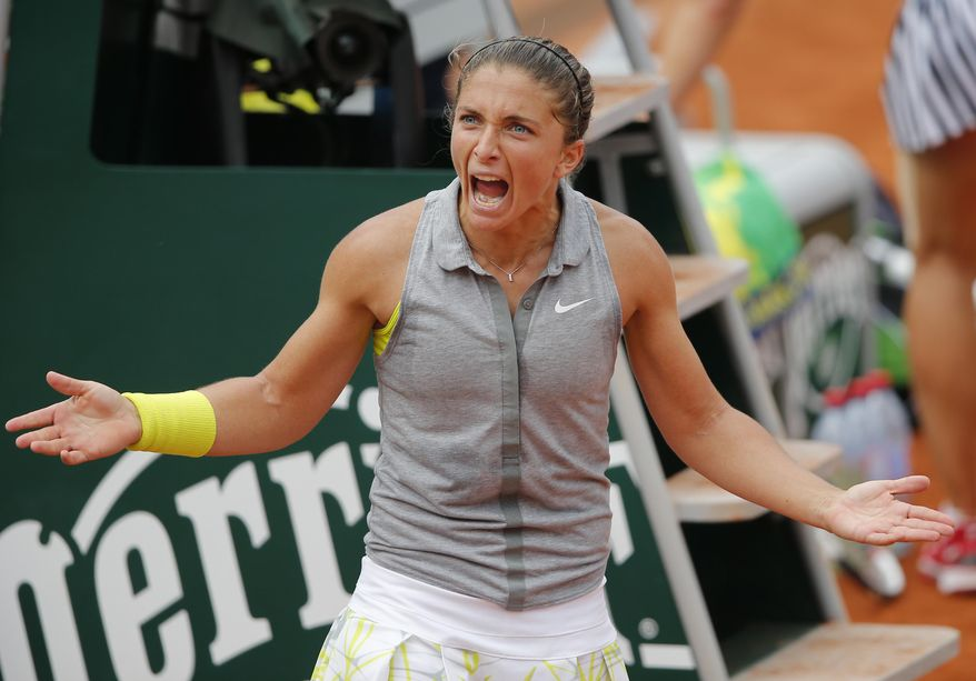 Italy's Sara Errani reacts after defeating Serbia's Jelena Jankovic during their fourth round match of  the French Open tennis tournament at the Roland Garros stadium, in Paris, France, Monday, June 2, 2014. (AP Photo/David Vincent)