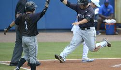 Long Beach State's Garrett Hampson (1) and Ino Patron, right, congratulate each other after both scored off a single by Michael Hill during the seventh inning of an NCAA college baseball regional tournament game against North Carolina in Gainesville, Fla., Monday, June 2, 2014. Long Beach State won 12-5.(AP Photo/Phelan M. Ebenhack)