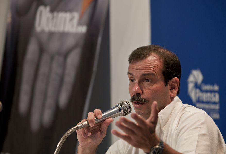 "Cuban intelligence agent Fernando Gonzalez, known as one of the ""Cuban Five,"" speaks during a press conference in Havana, Cuba, Monday, June 2, 2014. Gonzalez who spent years in jail in the United States says the exchange of five Taliban detainees for a U.S. Army sergeant held captive in Afghanistan could set a precedent for a similar swap with Cuba. Gonzalez said Monday that the only thing needed is political will by the Obama administration to negotiate a swap of U.S. government subcontractor Alan Gross for three Cuban agents still imprisoned in the United States. (AP Photo/Franklin Reyes)"