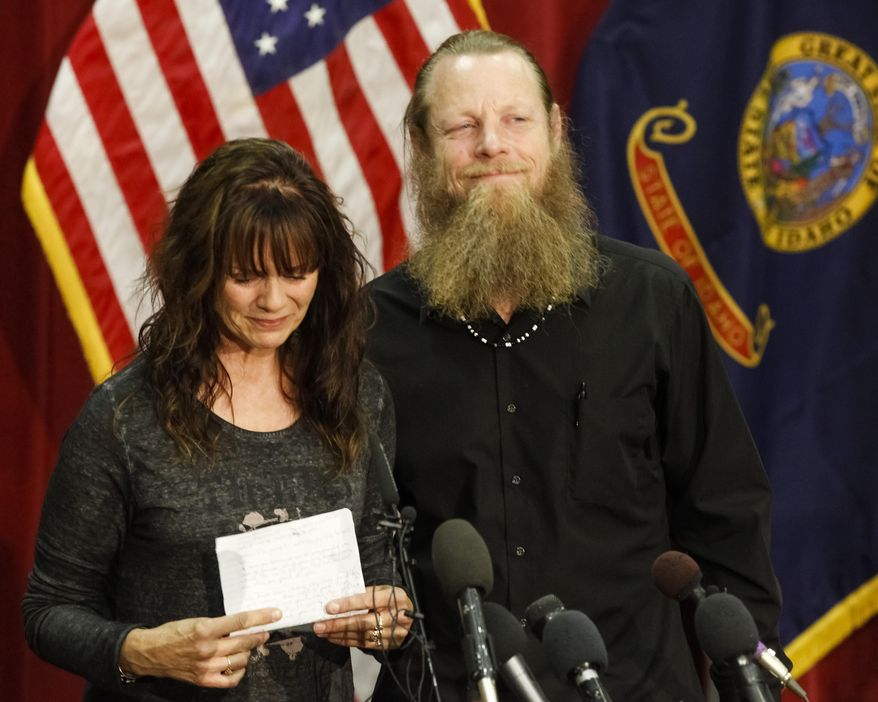 Jani and Bob Bergdahl speak to the media during a news conference at Gowen Field in Boise, Idaho, on Sunday, June 1, 2014, regarding their son, Army Sgt. Bowe Bergdahl. Sgt. Bergdahl can expect a buoyant homecoming after five years in Taliban hands, but those in the government who worked for his release face mounting questions over the prisoner swap that won his freedom. (AP Photo/Otto Kitsinger)