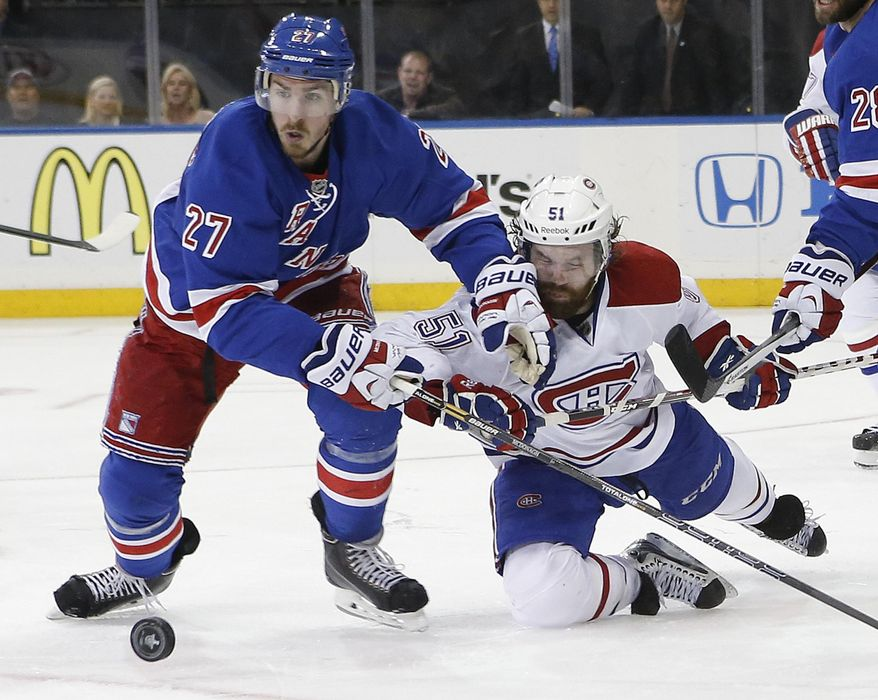 New York Rangers defenseman Ryan McDonagh (27) collides with Montreal Canadiens center David Desharnais (51) during the third period in Game 6 of the NHL hockey Stanley Cup playoffs Eastern Conference finals, Thursday, May 29, 2014, in New York. (AP Photo/Kathy Willens)