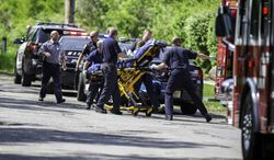 In this Saturday, May 31, 2014, photo, rescue workers take a stabbing victim to the ambulance in Waukesha, Wis. Prosecutors say two 12-year-old southeastern Wisconsin girls stabbed their 12-year-old friend nearly to death in the woods to please a mythological creature they learned about online. (AP Photo/Abe Van Dyke)