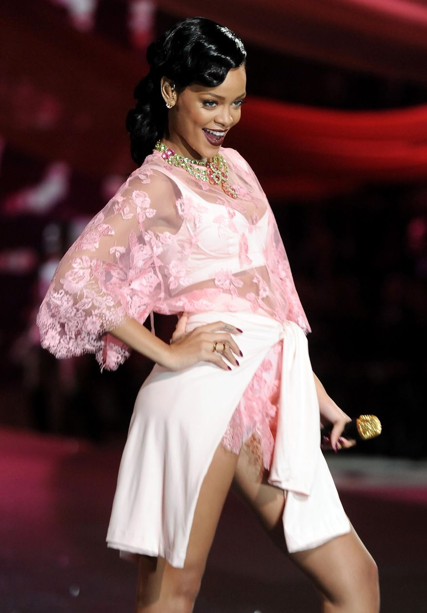 FILE - This Nov. 7, 2012 file photo shows singer Rihanna during the 2012 Victoria's Secret Fashion Show in New York. Rihanna is being honored with the fashion icon award by the Council of Fashion Designers of America on Monday, June 2, 2014. (Photo by Evan Agostini/Invision/AP, File)