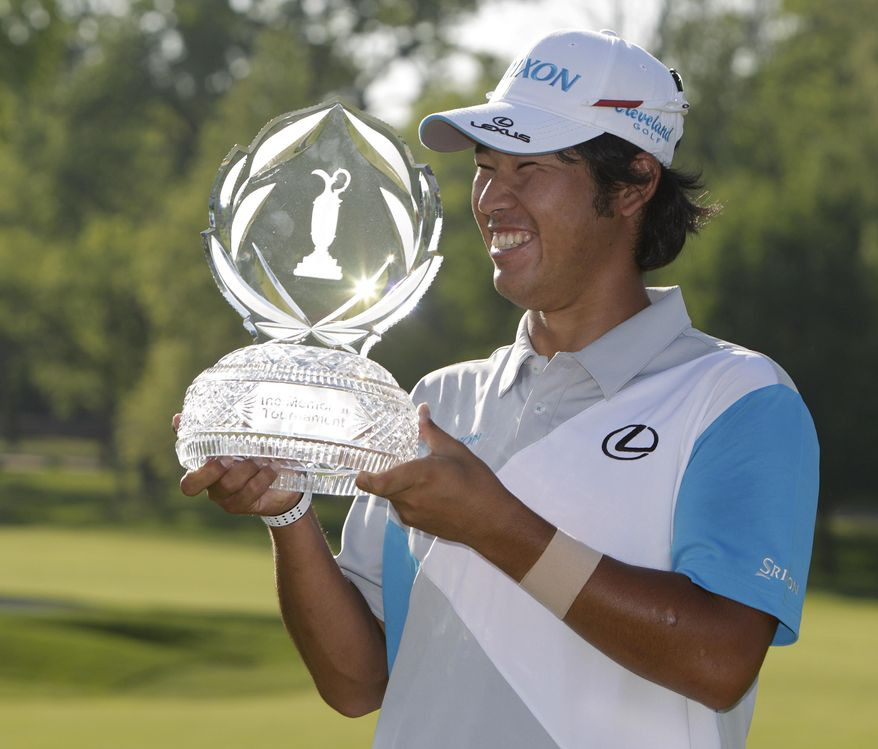Hideki Matsuyama, of Japan, holds the trophy after winning the Memorial golf tournament on the first playoff hole Sunday, June 1, 2014, in Dublin, Ohio. (AP Photo/Jay LaPrete)