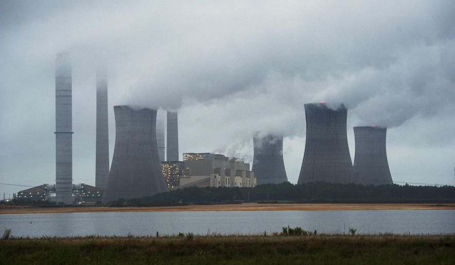 The coal-fired Plant Scherer is shown in operation early Sunday, June 1, 2014, in Juliette, Ga. The Obama administration unveiled a plan Monday to cut carbon dioxide emissions from power plants by nearly a third over the next 15 years, in a sweeping initiative to curb pollutants blamed for global warming. (AP Photo/John Amis)