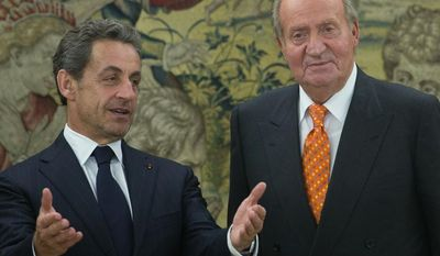 ** FILE ** Former French President Nicolas Sarkozy, left and Spain's King Juan Carlos pose for photographers before a meeting at the Zarzuela Palace in Madrid,  Spain, Tuesday, May 27, 2014. (AP Photo/Paul White)