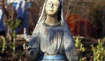 In this Feb. 8, 2014 photo, a weathered statue of the Virgin Mary stands in the yard of Our Lady of Fatima center during a religious gathering organized by the center in the village of Bois-Neuf, Haiti.  The 2010 earthquake in Haiti that killed tens of thousands of people and displaced 1.5 million others was on the minds of many pilgrims, and cited as a chief reason to have faith in God. (AP Photo/Dieu Nalio Chery)