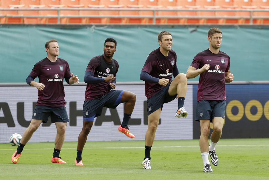 England players Wayne Rooney, left, Daniel Sturridge, second from left, Rickie Lambert, second from right, and Gary Cahill, right, warm up during practice, Tuesday, June 3, 2014 in Miami Gardens, Fla. England plays matches at Sun Life Stadium, against Ecuador on Wednesday and Honduras on Saturday. (AP Photo/Wilfredo Lee)