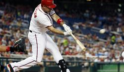 Washington Nationals' Ryan Zimmerman hits a one RBI double during the fifth inning of a baseball game against the Philadelphia Phillies at Nationals Park Tuesday, June 3, 2014, in Washington. (AP Photo/Alex Brandon)