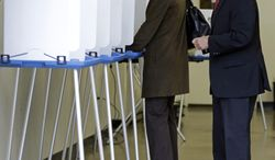 California Gov. Jerry Brown, right, speaks to a voter as he leaves a polling area Tuesday, June 3, 2014, in Oakland, Calif. (AP Photo/Ben Margot)