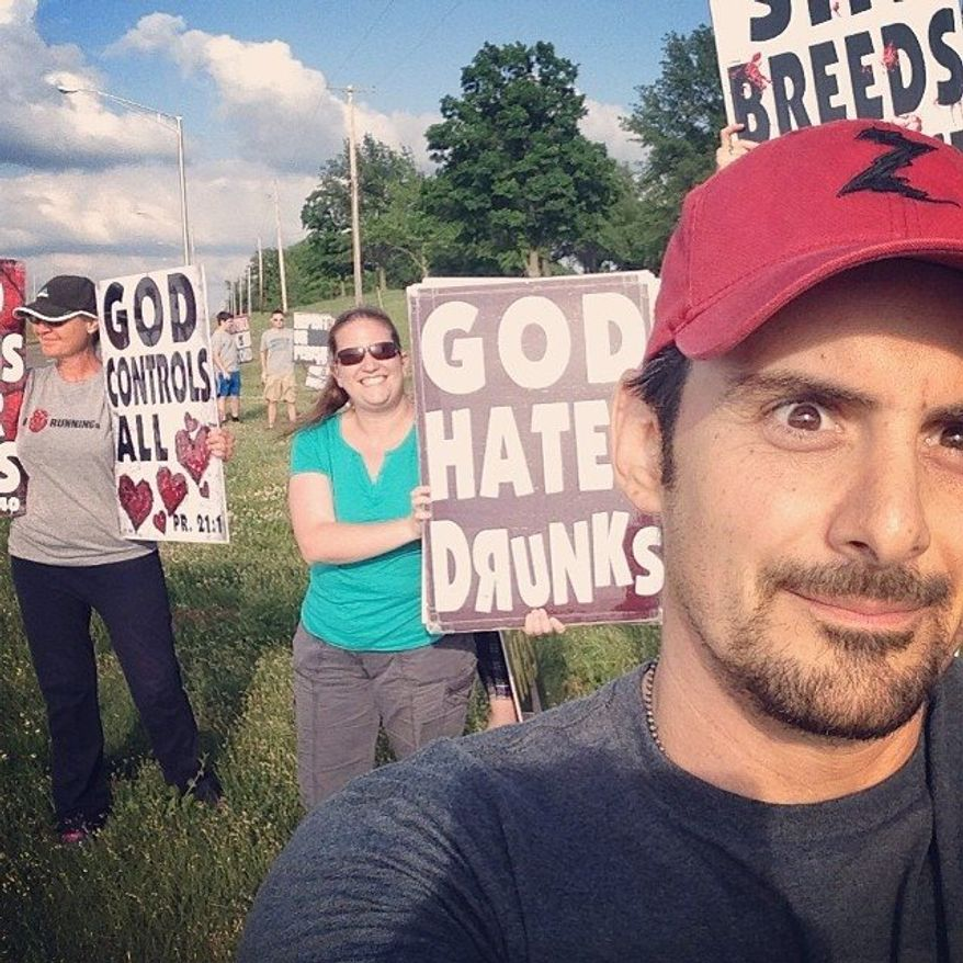 Protesters with the Westboro Baptist Church showed up at a Brad Paisley concert in Bonner Springs, Kansas, on Sunday and got to be part of an ironic selfie that the country music star posted online. (Brad Paisley via Facebook)