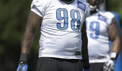 Detroit Lions defensive tackle Nick Fairley watches during NFL football practice in Allen Park, Mich., Tuesday, June 3, 2014. (AP Photo/Paul Sancya)