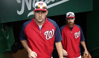 Washington Nationals' Ryan Zimmerman, left, and Adam LaRoche arrive into the dugout before a baseball game against the Philadelphia Phillies at Nationals Park on Tuesday, June 3, 2014, in Washington. It is expected to be Zimmerman's first game back after being on the disabled list. (AP Photo/Alex Brandon)