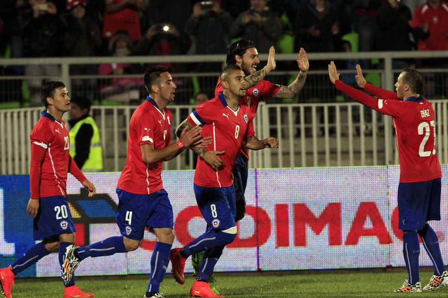 Chile's Charles Aranguiz, left,  Mauricio Isla, second left, Arturo Vidal, center,  Mauricio Pinilla, second right, and Marcelo Diaz celebrate after scoring against Northern Ireland, at a friendly soccer match in Valparaiso, Chile, Wednesday, June 4, 2014. (AP Photo/Luis Hidalgo)