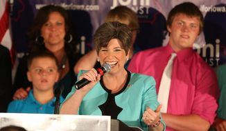 Joni Ernst delivers her remarks at a victory celebration during a primary election night party on Tuesday, June 3, 2014, at the Des Moines Social Club in downtown Des Moines, Iowa. (AP Photo/The Des Moines Register, Charlie Litchfield) ** FILE **