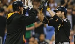 Pittsburgh Pirates' Neil Walker, right, is congratulated by Gerrit Cole after his two-run home run against the San Diego Padres in the third inning of a baseball game Tuesday, June 3, 2014, in San Diego. (AP Photo/Lenny Ignelzi)