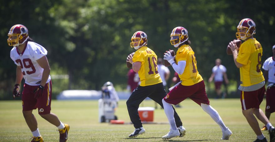 Washington Redskins quarterback Colt McCoy (16) joins quarterback Robert Griffin III (10) and Kirk Cousins (8) during passing drills on the practice field during an OTA at Redskins park in Ashburn, Va., Wednesday, June 4, 20124. (Photo Rod Lamkey Jr.)