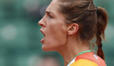 Germany's Andrea Petkovic celebrates winning the first set of the quarterfinal match of the French Open tennis tournament against Italy's Sara Errani at the Roland Garros stadium, in Paris, France, Wednesday, June 4, 2014.  (AP Photo/Darko Vojinovic)