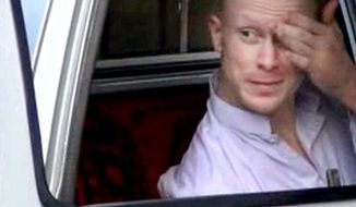 In this image taken from video obtained from Voice Of Jihad website, which has been authenticated based on its contents and other AP reporting, Sgt. Bowe Bergdahl, sits in a vehicle guarded by the Taliban in eastern Afghanistan. (AP Photo/Voice Of Jihad Website via AP video)