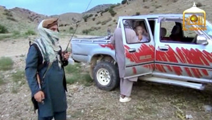 In this image taken from video obtained from the Voice of Jihad Web site, Sgt. Bowe Bergdahl sits in a vehicle guarded by the Taliban in eastern Afghanistan. (Associated Press)