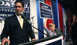 Chris McDaniel addresses his supporters as his son Cambridge, 7, joins him on the stage at the Lake Terrace Convention Center in Hattiesburg, Miss., on election night. With a third candidate on the ballot, neither Mr. Cochran nor Mr. McDaniel managed to get at least 50 percent plus one vote, the threshold to win outright and avoid a June 24 runoff. (Associated Press)