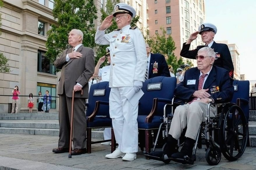 Battle of Midway veterans render salute during a ceremony at the Navy Memorial to commemorate the anniversary of the fateful Pacific campaign. The battle marked the turning point against the Japanese.
