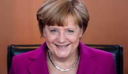 German Chancellor Angela Merkel smiles as she arrives for the weekly cabinet meeting at the chancellery in Berlin, Wednesday, June 4, 2014. (AP Photo/Markus Schreiber)