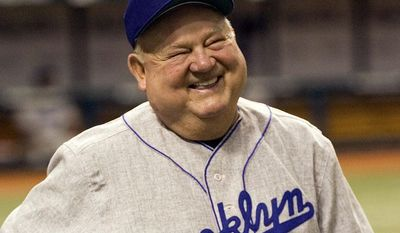 "Tampa Bay Devil Rays coach Don Zimmer, and member of the 1955 world champion Brooklyn Dodgers, smiles during a pre-game tribute to Zimmer before a ""Turn Back the Clock""  interleague baseball game against the Los Angeles Dodgers Saturday, June 23, 2007 in St. Petersburg, Fla. Los Angeles players wore the uniforms from the Brooklyn team and Tampa Bay players wore uniforms from the St. Petersburg Saints of the Florida State League. (AP Photo/Steve Nesius)"