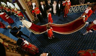 Britain's Queen Elizabeth II, centre left, and Prince Philip, the Duke of Edinburgh,  proceed through the Royal Gallery, during the State Opening of Parliament,  in the House of Lords, in London, Wednesday June 4, 2014. The State Opening of Parliament is an annual pageant of pomp and politics centred on the Queen's Speech, a legislative program written by the government but read out by the monarch before a crowd of lawmakers, ermine-robed peers and ceremonial officials in bright garb evoking centuries past. (AP Photo/Yui Mok, Pool)