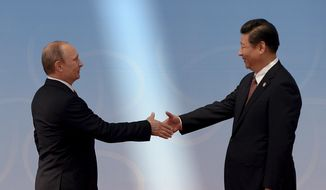 """FILE - In this May 21, 2014 file photo, Russian President Vladimir Putin, left, is greeted by Chinese President Xi Jinping before the opening ceremony at the fourth Conference on Interaction and Confidence Building Measures in Asia (CICA) summit in Shanghai, China. Angry with the West's response over Ukraine, Russia is moving rapidly to bolster ties with North Korea in a diplomatic nose-thumbing that could complicate the U.S.-led effort to squeeze Pyongyang into giving up its nuclear weapons program. Russia's proactive strategy in Asia- which also involves cozying up to China and had been dubbed """"Putin's Pivot"""" - began years ago as Moscow's answer to Washington's much touted rebalancing of its military forces in the Pacific. (AP Photo/Mark Ralston, Pool, File)"""