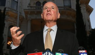 Gov. Jerry Brown talks to reporters outside the Old Governors Mansion on election night in Sacramento, Calif., Tuesday, June 3, 2014.  Brown easily advanced to the November general election with early returns showing  him with 57 percent of the vote. (AP Photo/Rich Pedroncelli)