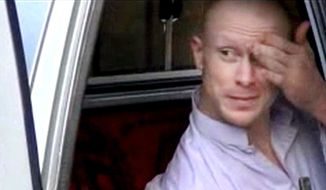 In this image taken from video obtained from Voice Of Jihad Website, which has been authenticated based on its contents and other AP reporting, Sgt. Bowe Bergdahl, sits in a vehicle guarded by the Taliban in eastern Afghanistan. The announcement that the U.S. government had secured Bergdahl's release and that it was freeing five senior Taliban figures from Guantanamo Bay has been portrayed first and foremost as a prisoner exchange. But the four-year history of secret dialogue that led to Saturday's release suggests that the main goal of each side may have been far more sweeping. (AP Photo/Voice Of Jihad Website via AP video)