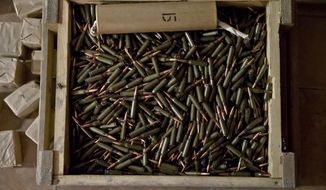 Abandoned ammunition lies on the floor of an Ukrainian border troops military unit in Luhansk, eastern Ukraine, Wednesday, June 4, 2014. The compound was seized by pro-Russian rebels who collected large amounts of weapons and ammunition left behind by the Ukrainian troops.(AP Photo/Vadim Ghirda) ** FILE **