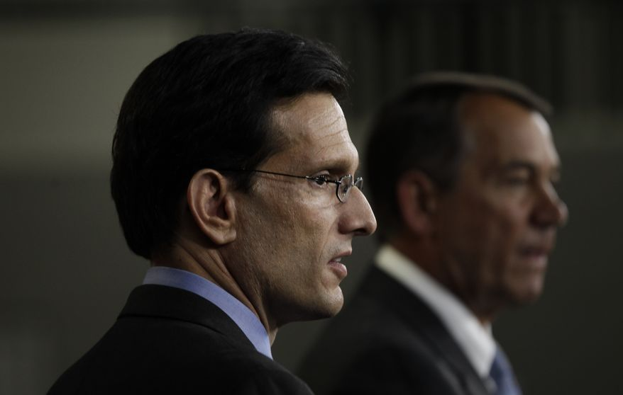** FILE ** In this Thursday, Jan. 6, 2011, file photo, House Speaker John Boehner of Ohio and Republican Majority Leader Eric Cantor of Virginia speak about repealing President Barack Obama's health care law at a news conference on Capitol Hill in Washington. (AP Photo/Charles Dharapak, File)