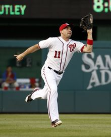 Washington Nationals left fielder Ryan Zimmerman catches a fly ball hit by Philadelphia Phillies' Chase Utley during the fourth inning of a baseball game at Nationals Park Tuesday, June 3, 2014, in Washington. (AP Photo/Alex Brandon)