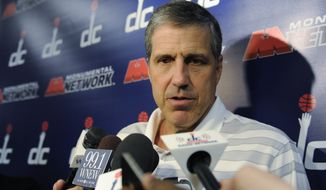 Washington Wizards head coach Randy Wittman speaks to reporters during a news conference at the Verizon Center in Washington, Wednesday, June 4, 2014. Wittman signed a contract extension Tuesday after leading the team to the playoffs for the first time since 2008. (AP Photo/Susan Walsh)